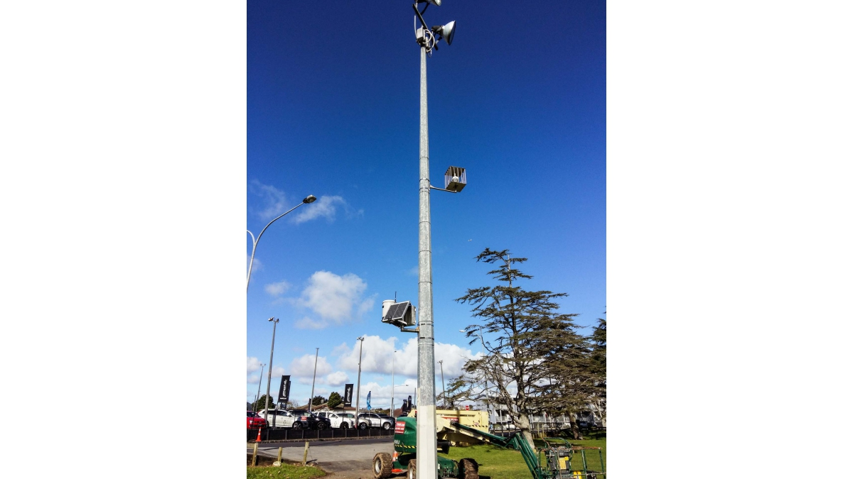 Public park with caged wind sensor to